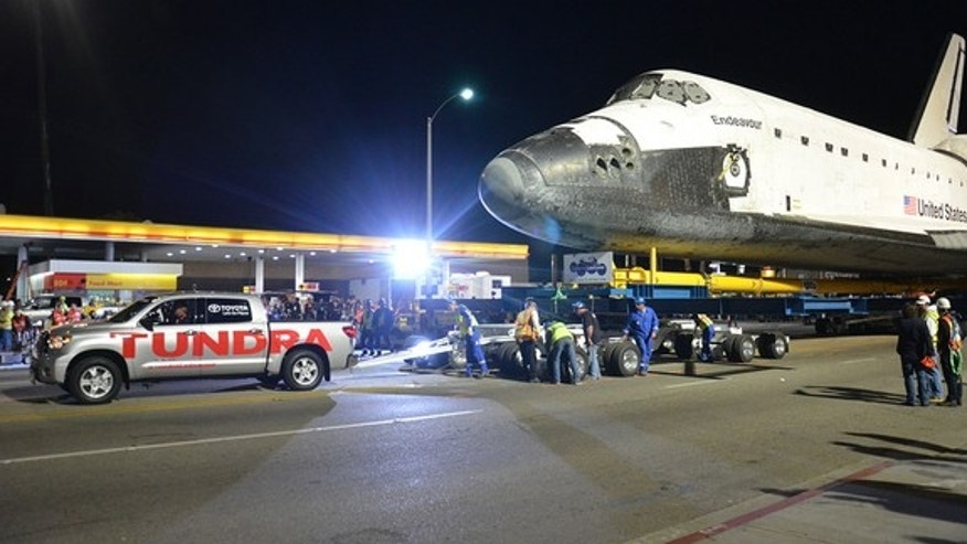 Space shuttle Endeavour is seen being towed by a 2012 Toyota Tundra truck in Los Angeles, Oct. 12, 2012.