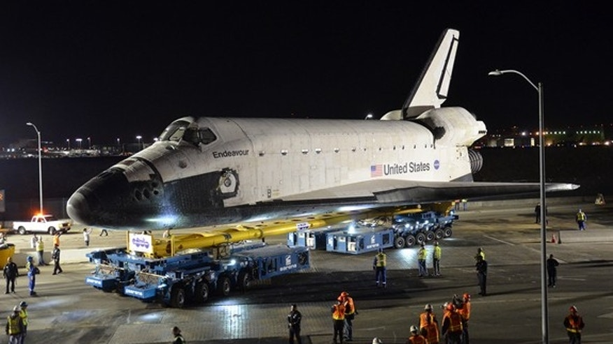 Space shuttle Endeavour is seen on top the overland transporter beginning its two-day, 12-mile L.A. road trip from Los Angeles International Airport to the California Science Center in the city on Oct. 12, 2012.