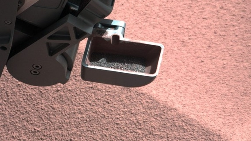 A sample of Mars dirt is shown in the scoop instrument of NASA's Curiosity Mars rover. The rover began using its scoop in October 2012, and this photo was taken by Curiosity's right Mast Camera (Mastcam-100) on Oct. 10, 2012, the 64th sol, or M