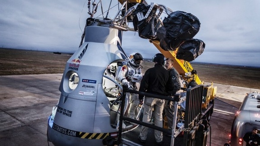 Pilot Felix Baumgartner of Austria stands on the step of his capsule during the preparation for the final manned flight of Red Bull Stratos in Roswell, New Mexico, on Oct. 6, 2012.