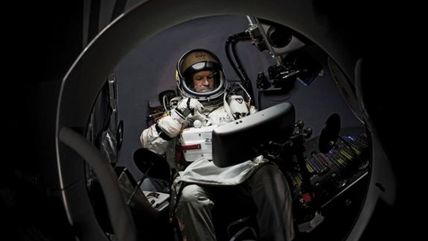 Pilot Felix Baumgartner of Austria sits in his capsule and prepares for the pre-breathing procedure during the preparations for the final manned flight of the Red Bull Stratos mission in Roswell, New Mexico, USA on October 6, 2012.