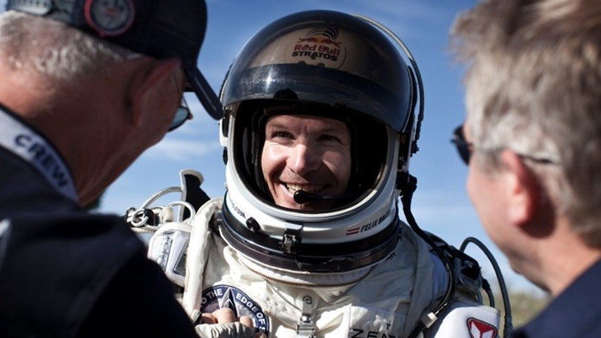 July 25, 2012: Pilot Felix Baumgartner of Austria celebrates after he lands at the desert during the second manned test flight for Red Bull Stratos in Roswell, New Mexico.