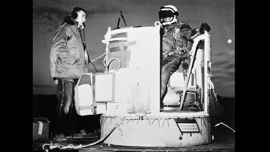 Nov. 16, 1959: Capt. Joseph Kittinger Jr., aerospace laboratory test director, sits in the open balloon gondola after his first parachute test jump for Project Excelsior at Holloman Air Force Base in Alamogordo, N.M.