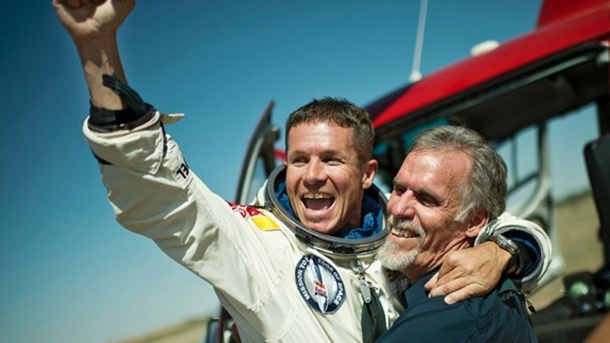 Skydiver Felix Baumgartner of Austria and Technical Project Director Art Thompson of the Unites States celebrate after successfully completing the world's highest skydive, a supersonic leap,  for Red Bull Stratos in Roswell, New Mexico, on Oct.