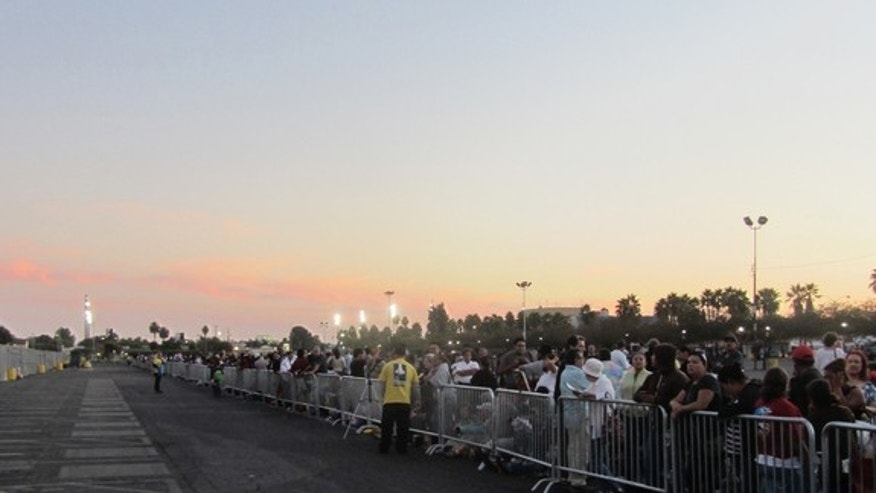 A crowd waits for shuttle Endeavour in a designated viewing lot near its museum home on Oct. 13, 2012, the day it was originally scheduled to arrive.