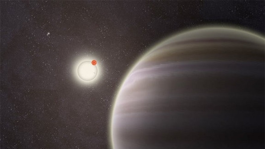 An artist's illustration of PH1, a circumbinary planet with two parent stars and twom more stars orbiting the entire system; PH1 was discovered by volunteers from the Planet Hunters citizen science project. Image released on Oct. 15, 2012.