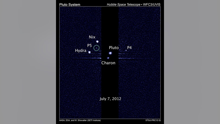 This image, taken by NASA's Hubble Space Telescope, shows five moons orbiting the distant, icy dwarf planet Pluto. The green circle marks the newly discovered moon, designated P5, as photographed by Hubble's Wide Field Camera 3 on July 7, 2012.