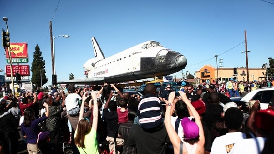 Retired shuttle Endeavour passes a Taco Bell at Martin Luther King Jr. Blvd. and Normandie Ave., Oct. 14, 2012.