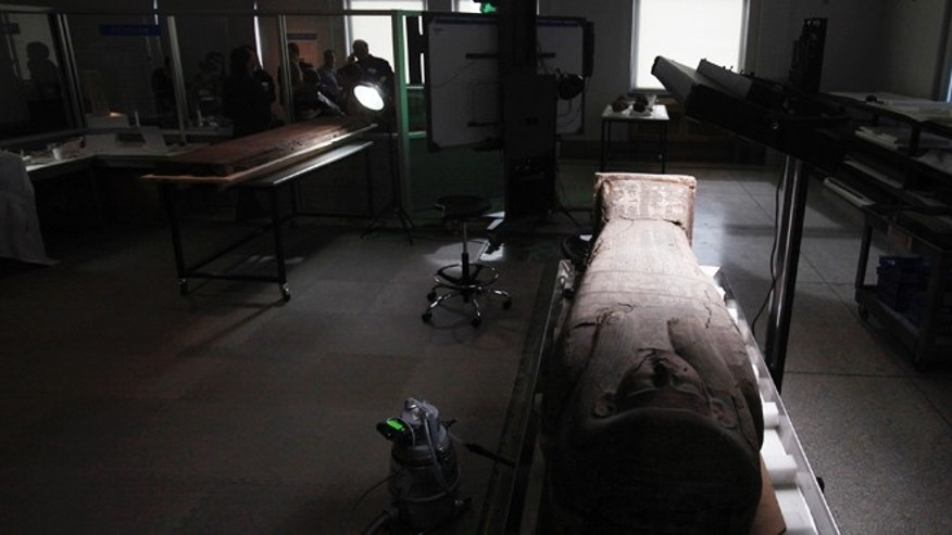 Oct. 19, 2012: A wooden sarcophagus is shown at the Penn Museum in Philadelphia. The newly installed Artifact Lab at the Penn Museum allows visitors to peek behind the scenes as staff members preserve relics from ancient Egypt.