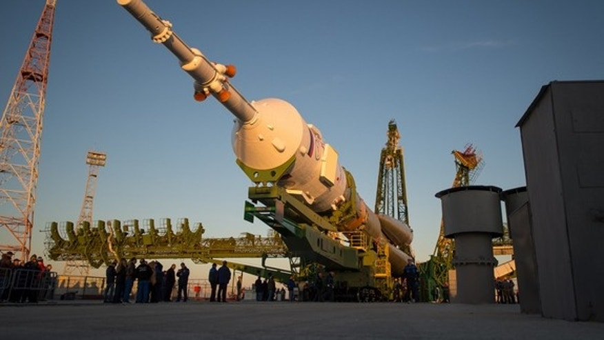 The Soyuz rocket is ready to be erected into position after being rolled out to the launch pad by train, on Sunday, October 21, 2012, at the Baikonur Cosmodrome in Kazakhstan. Launch of the Soyuz rocket is scheduled for October 23 and will send