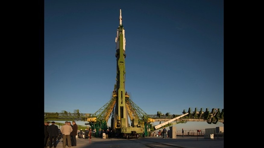 Oct. 21, 2012: The Soyuz rocket is erected into position after being rolled out to the launch pad by train, at the Baikonur Cosmodrome in Kazakhstan.