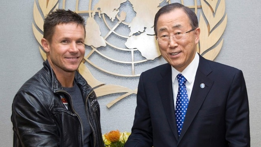 Oct. 23, 2012: In this photo provided by the United Nations, Austrian skydiver, base jumper and daredevil Felix Baumgartner, left, and United Nations Secretary General Ban Ki-moon pose for photographers at United Nations Headquarters.