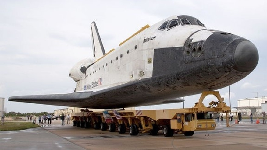 Space shuttle Atlantis moving on the Orbiter Transporter System (OTS) at NASA's Kennedy Space Center in Florida. The same OTS will be used to deliver Atlantis to the Kennedy Space Center Visitor Complex on Nov. 2, 2012.