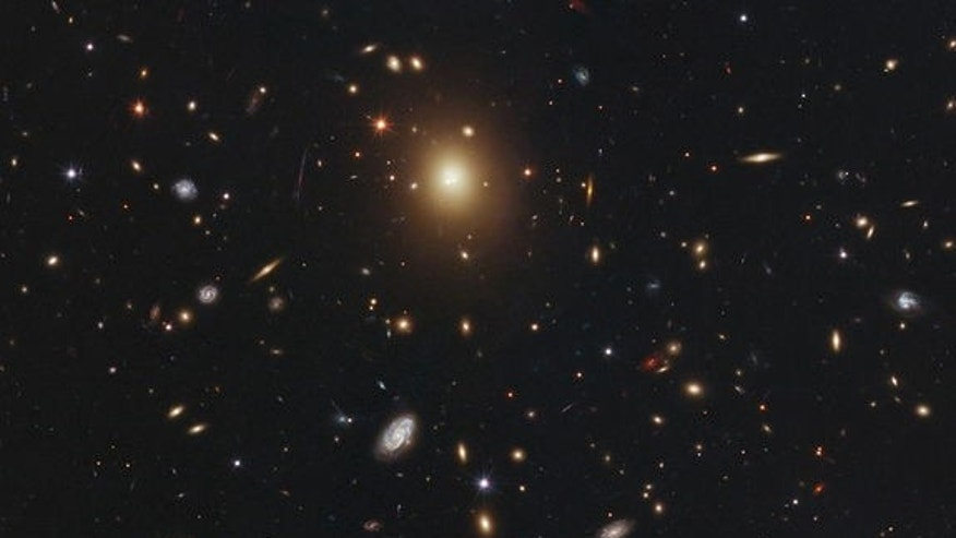 The giant elliptical galaxy in the center of this image, taken by NASA's Hubble Space Telescope, is the most massive and brightest member of the galaxy cluster Abell 2261. Image released Oct. 25, 2012.