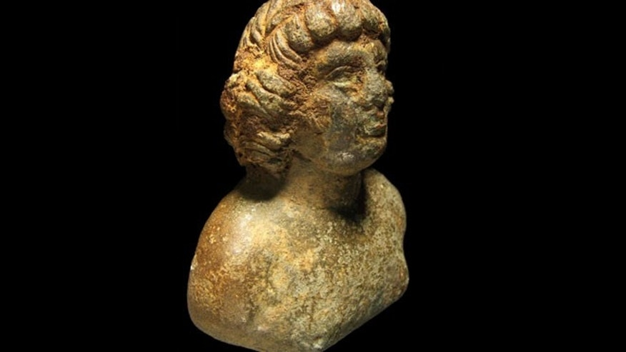 This copper alloy bust of a bare-chested young man may be of Antinous, a male lover of Emperor Hadrian who was deified after he died. Only two other examples are known from Britain.