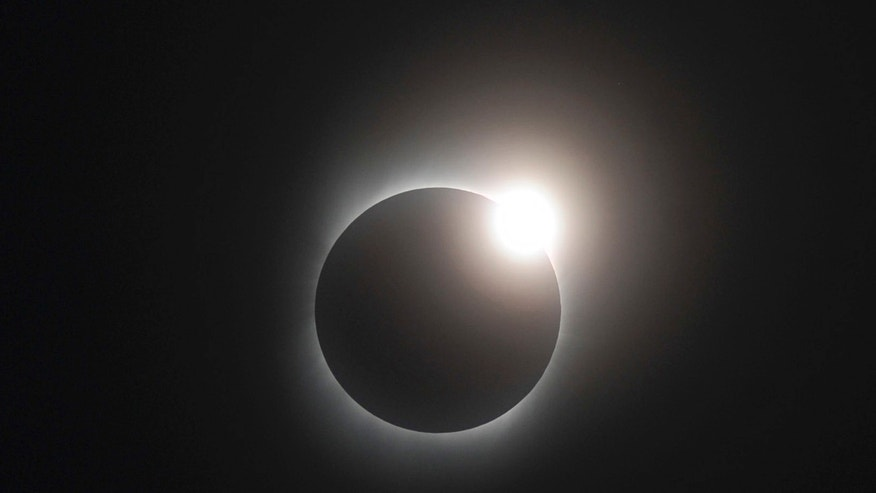 In this photo released by Xinhua News Agency, the Baily's Beads of solar eclipse is seen in southwest China's Chongqing Municipality, at 9:16 a.m. on Wednesday, July 22, 2009. Hundreds of millions of people across China, India and Japan will witness the longest solar eclipse of the century on Wednesday. (AP Photo/Xinhua, Yang Lei) ** NO SALES **