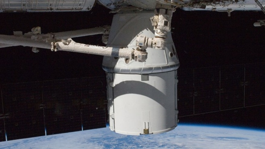 Oct. 10, 2012: The SpaceX Dragon commercial cargo craft is berthed to the Earth-facing side of the International Space Station's Harmony node.