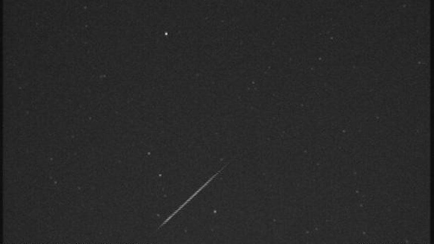 An Orionid meteor streaks across the night sky over Huntsville, Ala., in this view from a camera at NASA's Marshall Space Flight Center before dawn on Oct. 21, 2012, during the peak of the Orionid meteor shower.