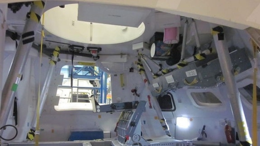 This view inside a mockup of NASA's new Orion space capsule shows a seat for an astronaut (eventually there will be four seats inside). Astronauts will lay on their backs with legs pointing up in the air on the leg rests, shown here.