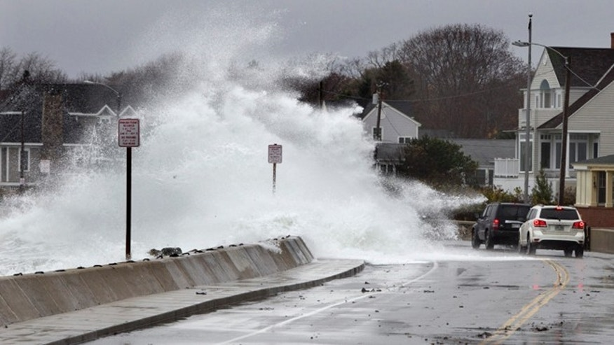 Oct. 29, 2012: Heavy surf crashes over a seawall on the Atlantic Ocean during the early stages of Hurricane Sandy in Kennebunk, Maine. But what caused the massivfe storm?
