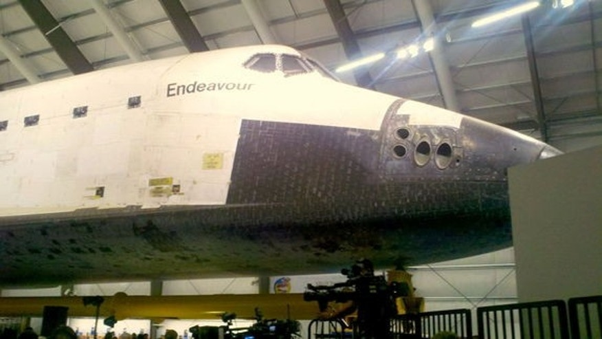 Endeavour is a tight fit inside its new home at the California Science Center, but the accommodations are temporary until a new facility can be completed.