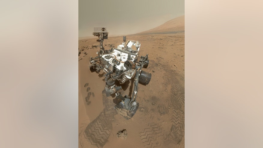 NASA's Mars rover Curiosity used its Mars Hand Lens Imager (MAHLI) to snap a set of 55 high-resolution images on Oct. 31, 2012. Researchers stitched the pictures together to create this full-color self-portrait.