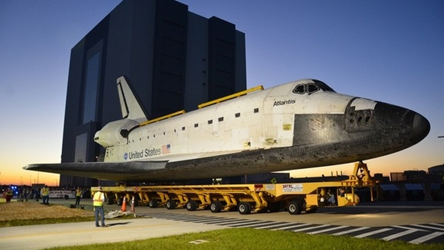 Space shuttle Atlantis, as seen leaving NASA's Vehicle Assembly Building for the final time. <a href=http://www.collectspace.com/news/news-110212b.html>See collectSPACE.com for more photos</a>.