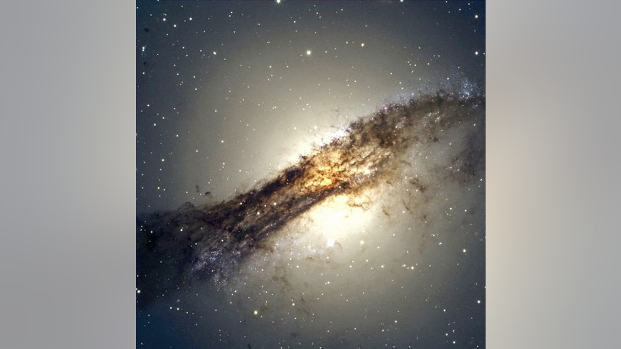 The giant elliptical galaxy Centaurus A shows a split personality because it hides a gaseous spiral at its core. When Centaurus A collided with a spiral galaxy 300 million years ago, it slurped up the spiral's gases, which formed a new spiral i
