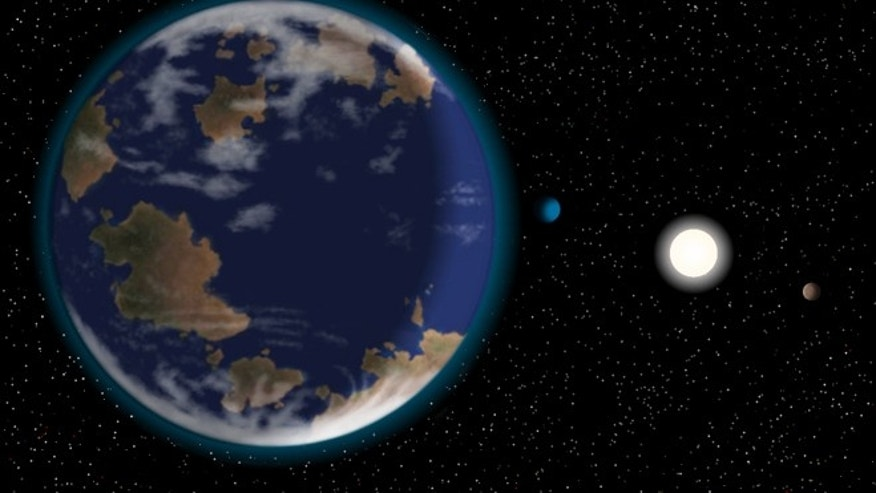 This artists impression shows the newfoun potentially habitable alien planet HD40307g in the foreground, with its host star and two other worlds in the six-planet system.