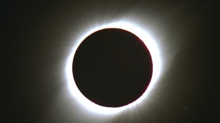 This photograph shows the total solar eclipse of Oct. 24, 1995, as seen from Dundlod, India.