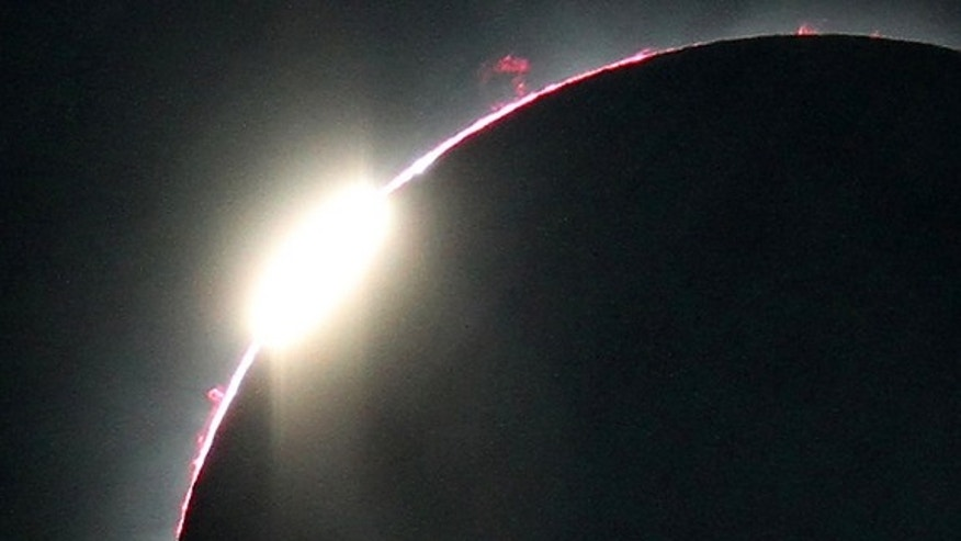This close-up view of the July 11, 2010, total solar eclipse's second diamond ring reveals a number of prominences as well as the pinkish layer of the sun's atmosphere called the chromosphere.