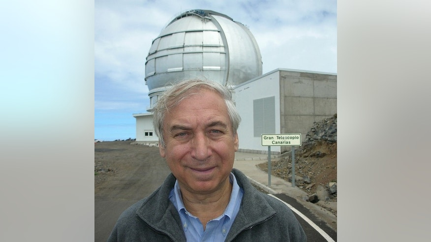 Jay Pasachoff, an astronomer at Williams College, standing in front of the largest telescope in the world, the 10.4-meter reflector in the Canary Islands.