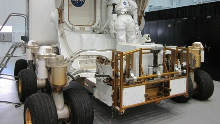 A mockup of NASA's next generation moon rover, the Space Exploration Vehicle (SEV), on display at the agency's Johnson Space Center in Houston. The SEV has since been converted into a wheel-less vehicle designed for visiting asteroids.