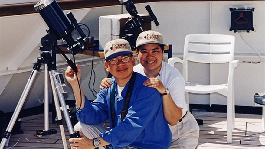 Veteran eclipse chasers Imelda Joson and Edwin Aguirre were all smiles after successfully observing the total solar eclipse on Feb. 26, 1998 aboard the MS Veendam in the Caribbean Sea.