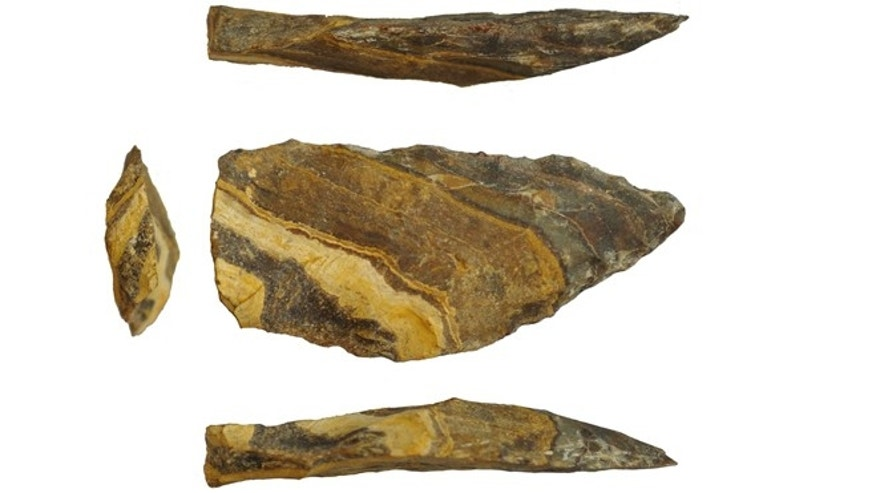 This undated image provided by Jayne Wilkins shows different angles of an estimated 500,000-year-old stone point from Kathu Pan, South Africa. The scale bar at bottom is 1 centimeter long. In a study published in the journal Science on Thursday, Nov. 15, 2012, scientists say theyve found evidence that stone tips for spears were made much earlier than thought, maybe even created by an earlier ancestor than has been believed. Both Neanderthals and members of our own species Homo sapiens used stone tips - a significant development that made spears more effective, lethal hunting weapons. The new findings from South Africa suggest that maybe they didnt invent that technology, but inherited it from their last shared ancestor, Homo heidelbergensis.