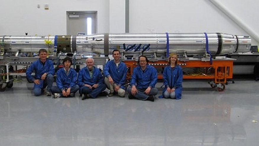 The FOXSI solar telescope team sits in front of the integrated payload before it gets ready for launch (from left to right: Paul Turin, Shinya Saito, Stephen McBride, Steven Christe, Säm Krucker, Lindsay Glesener). The rocket launched on Nov. 2