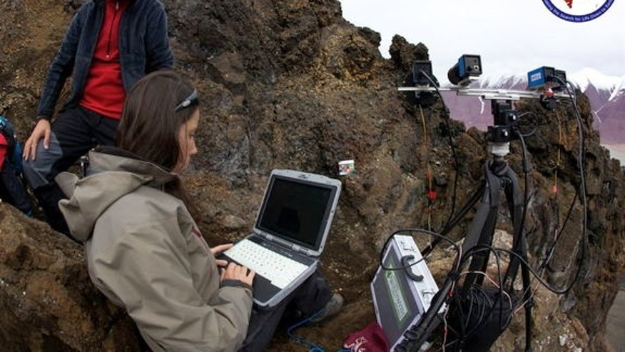 ExoMars PanCam deployed on Commanche Spur analogue carbonates in lava breccia at Sverrefjell volcano on AMASE 2011. Left: Arnold Bauer, Joanneum Research, Austria; Right: Nicole Schmitz, German Aerospace Center (DLR).