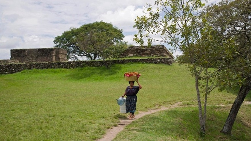 Sept. 21, 2012: A woman carries a basket of food at the Mixco Viejo archaeological site, in San Martin Jilotepeque, during a special series of events that celebrate the Mayan culture as the country prepares to commemorate the dawn of a new era on Dec. 21, 2012.