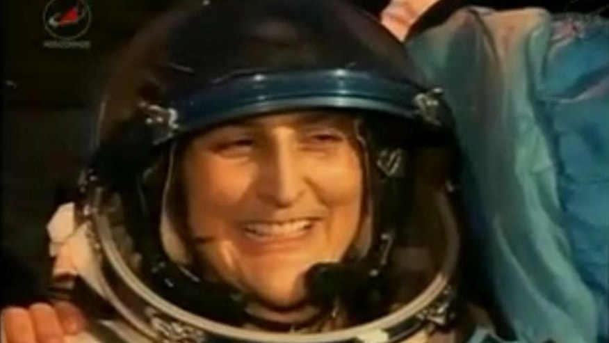 NASA astronaut Sunita Williams, Expedition 33 commander, smiles after returning to Earth on Nov. 18 (EST), 2012, aboard a Soyuz TMA-05M space capsule. Williams and two crewmates landed on the frigid steppes of Kazakhstan in Central Asia after a