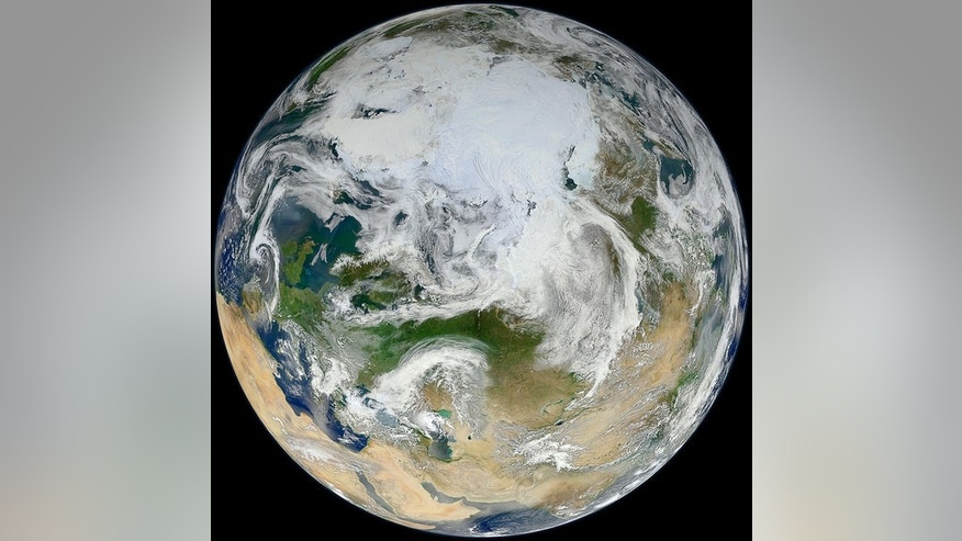 The 'blue marble' of earth gets a makeover in this view of the arctic as seen by the Suomi NPP satellite. Image released June 18, 2012.