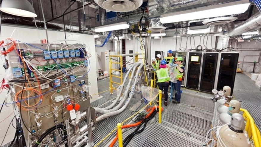 July 31, 2012: Researchers work on the top floor of the Large Underground Xenon experiment at a shuttered gold mine in Lead, S.D. The experiment, known as LUX, could begin collecting data on dark matter as early as February.