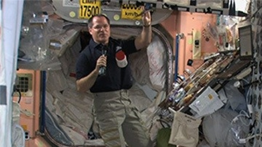 NASA astronaut Kevin Ford holds a packet of smoked turkey that will up part of the space station crew's Thanksgiving feast on Nov. 22, 2012.