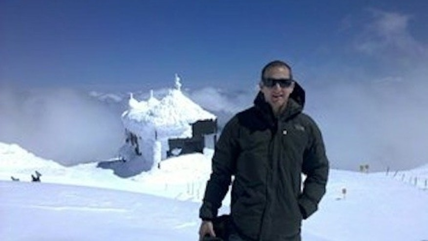 David Smith in front of the Mt. Bachelor Observatory, where atmospheric samples are collected.