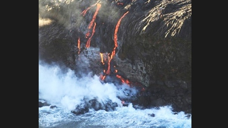 Nov. 24, 2012: Lava overtopped a seaside cliff in Hawaii sending up steam plumes.