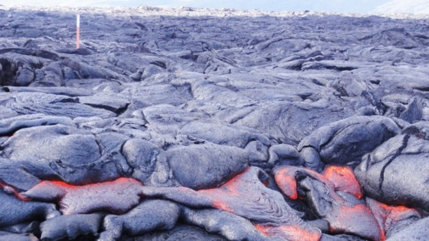 Nov. 10, 2012: The slow-moving molten rock shown here is a sticky form of lava called pahoehoe.