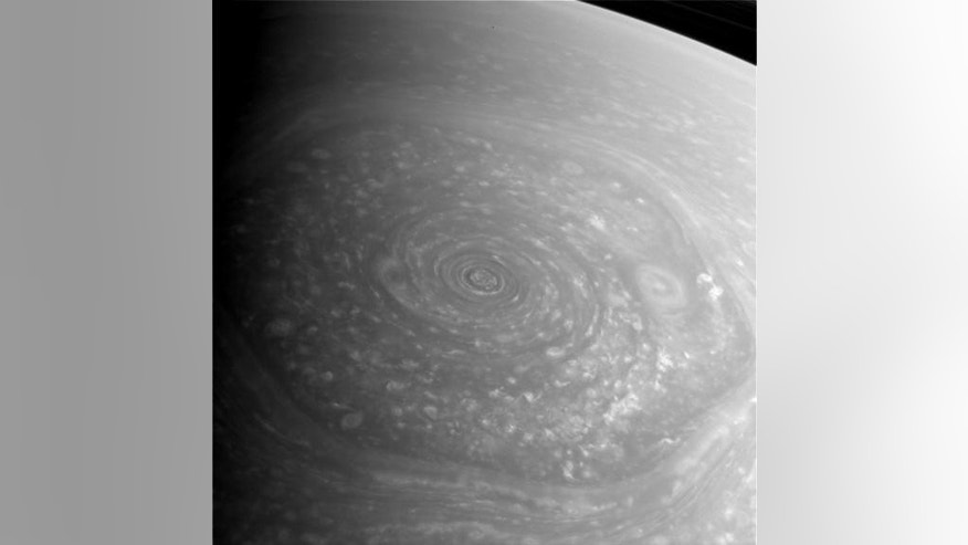Saturn's mysterious northern vortex, a vast hexagon-shaped storm, dominates this photo taken Nov. 27, 2012, by NASA's Cassini spacecraft. This image is a raw and unprocessed view.