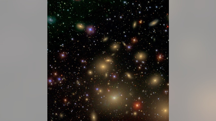 The small galaxy NGC 1277 is home to a colossal supermassive black hole and is embedded in the nearby Perseus galaxy cluster, at a distance of 250 million light-years from Earth. NGC1277 is the small galaxy in the center of this image. Compared