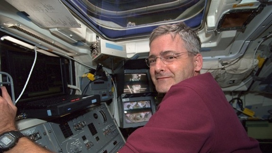 Former Canadian astronaut Marc Garneau at the controls of the Canadian robotic arm during his last mission in space, STS-97, in 2000.