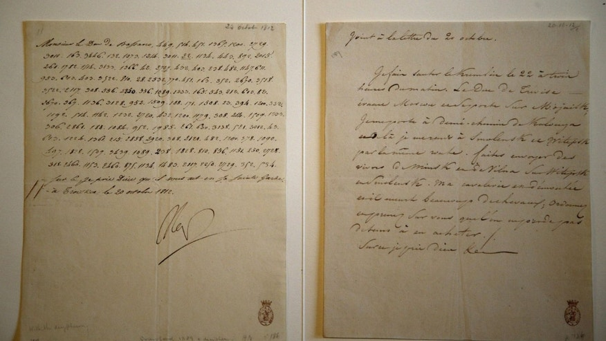 "Nov. 28, 2012: A letter dictated and signed by Napoleon in secret code that declares his intentions ""to blow up the Kremlin"" during his ill-fated Russian campaign is displayed in Fontainebleau, outside Paris."