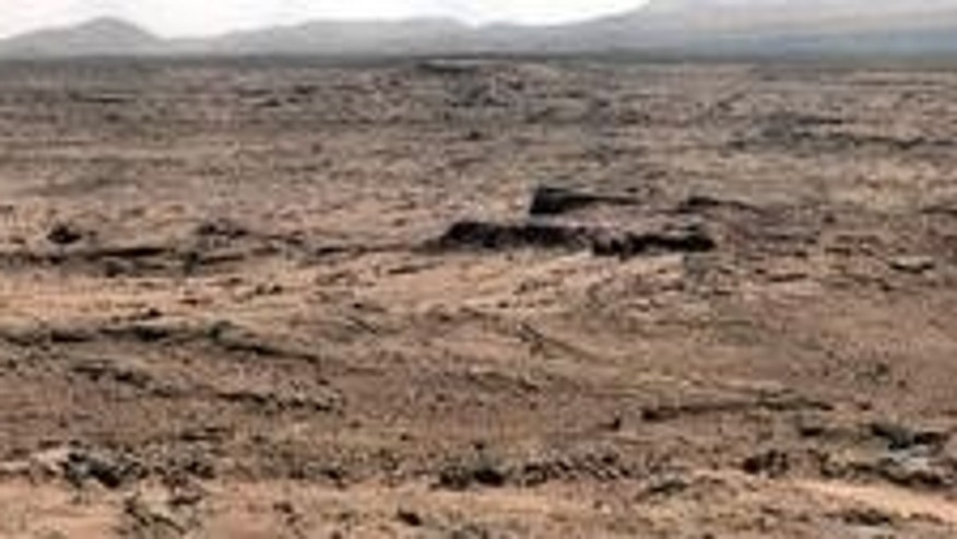 "This panorama is a mosaic of images taken by the Mast Camera (Mastcam) on NASA's Mars rover Curiosity while the rover was working at a site called ""Rocknest"" in October and November 2012."